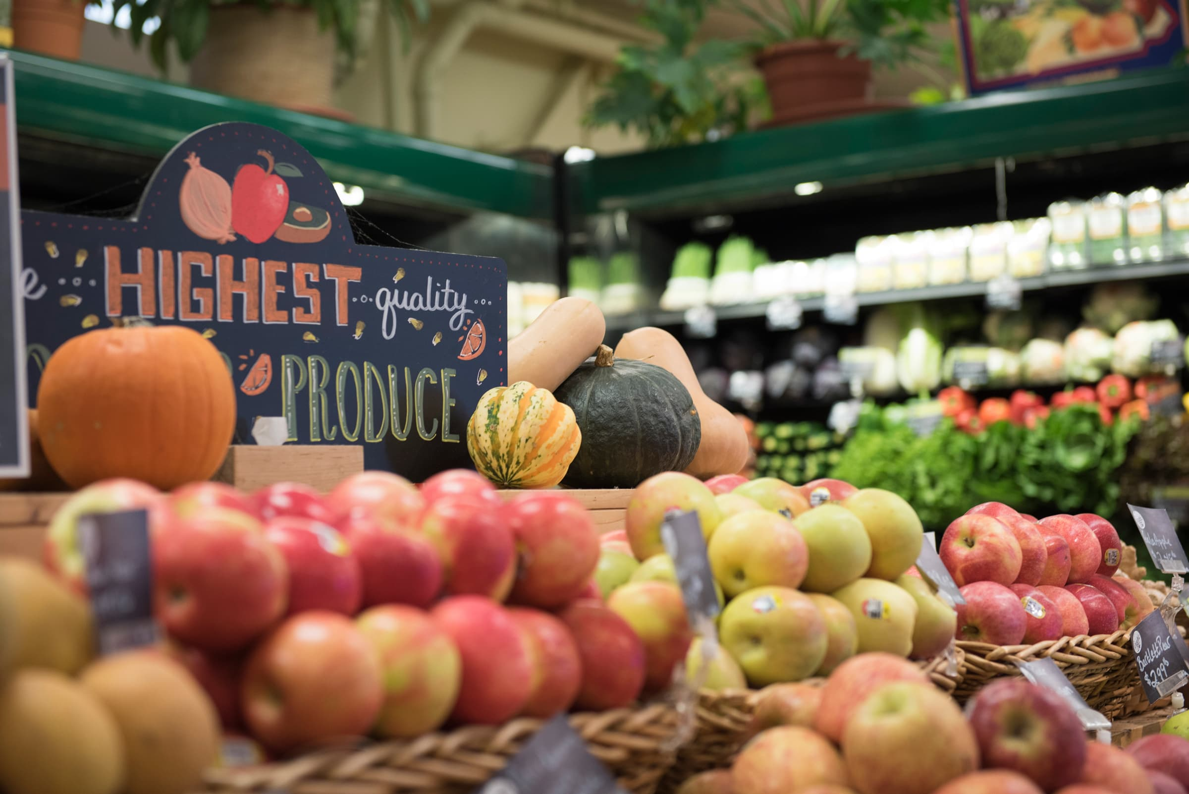 Photo of grocery store produce section showing a variety of fruits and vegetables.